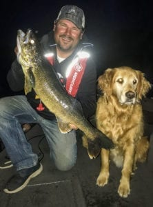 Steve with Walleye and dog