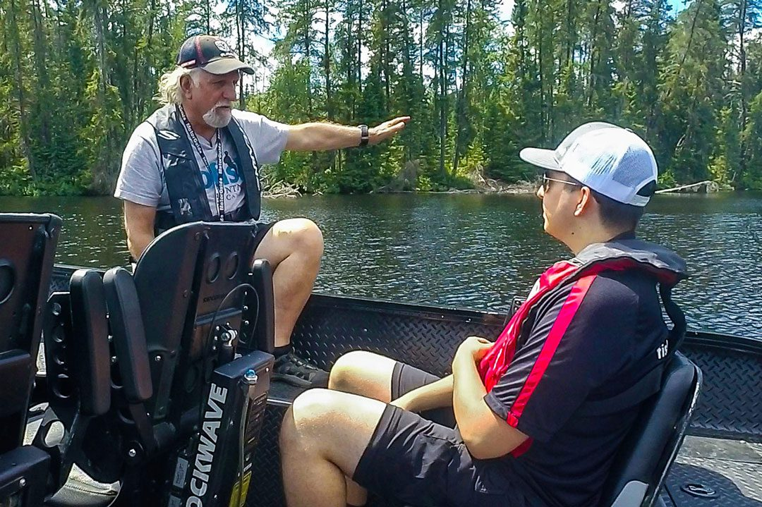 Nik getting a lesson in Topwater Smallmouth Fishing