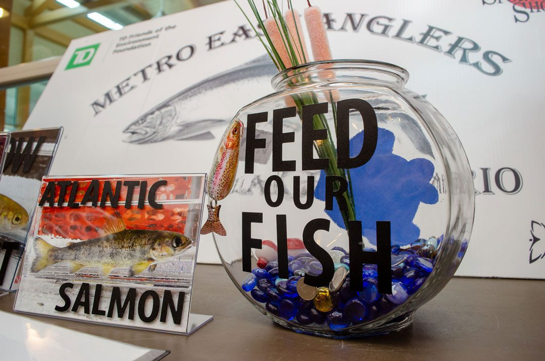 A bowl that reads Feed Our Fish and Atlantic Salmon